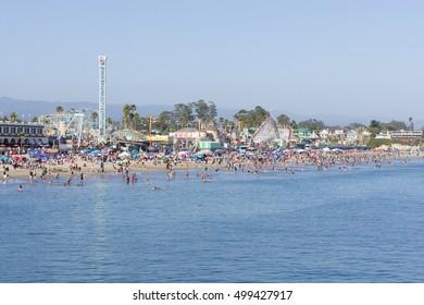 People on beach and amusement park at the Boardwalk in Santa Cruz