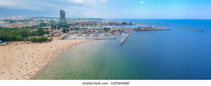 People on the beach at Baltic Sea in Gdynia, Poland.