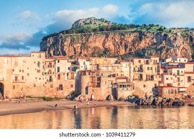 People on the beach of Cefalu, little town on the sea in Sicily, Italy