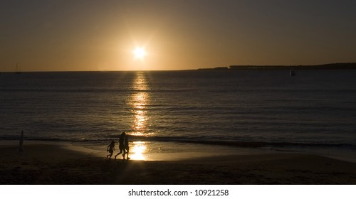 People on beach during sunset punta del este