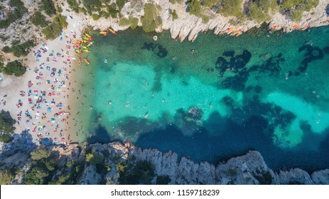 People on the beach in France. Aerial view of luxury resting at sunny day. Summer seascape from air. Top view from drone. Travel concept and idea
