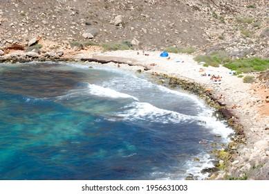 People on the beach of Lampedusa. Summer 2009.