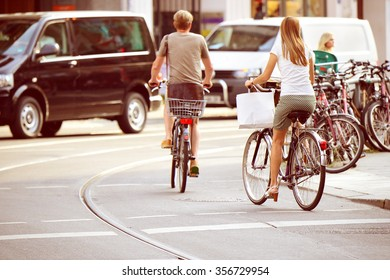 People on bikes in traffic