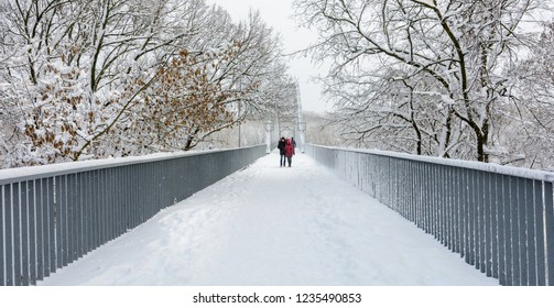 People on the bridge. Gomel. Belarus. 2. April. 2018. Winter in Gomel. Belarus. People walk on the pedestrian bridge over the river Sozh.