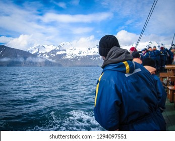 People on a eco-friendly whale watching ship in Husavik, on the north coast of Iceland