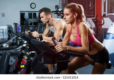 people on elliptical trainer