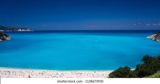 People on the Greek beach of Myrthos on Kefalonia island