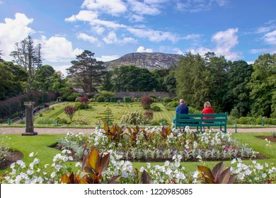 People on Park Bench Overlooking Connemara National Park, Kylemore, Galway, Ireland