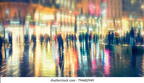 people on the rainy night in the city, urban night life