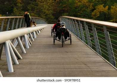 People on recumbent bicycles on a bridge in Maribor, Slovenia.