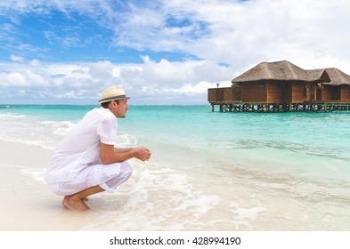 People on the shore enjoying the exotic view of sitting