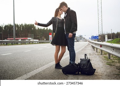 people on the side of the car brake. hitchhiking, couple in love,