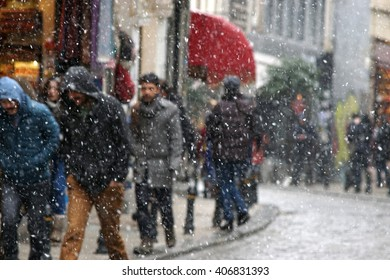 People on the Street at a Snowing Day