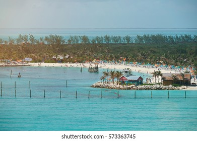 People on vacations on caribbean beach. A lot of people on blue water beach