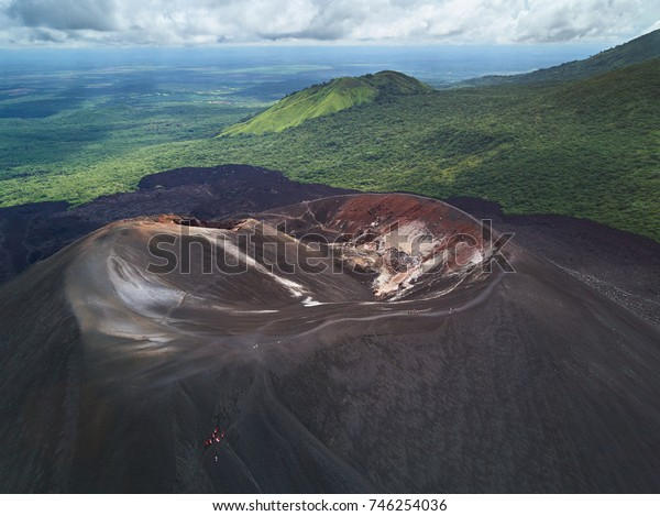 People on volcano sliding tour in Nicaragua aerial drone view