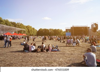 People at open air concert on sunny day