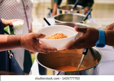 People outreach to donate food from volunteers : Free food for poor and homeless people donates food to food less people : Social concept of poor people sharing.