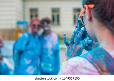 People participating in the Color Run. The Color Run is a worldwide hosted 5K fun race