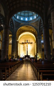People participating in a Mass in a Catholic Church. Back view. July 2015, Merida, Mexico.