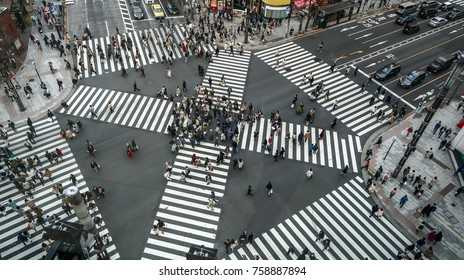People passing the street crossing in Ginza district, Tokyo. Crosswalk. Intersection in Tokyo