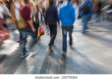people in a pedestrian zone of the city with creative zoom effect, made by camera