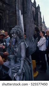 people perform on the street at the Edinburgh Festival Fringe in Edinburgh, UK on August 5, 2012