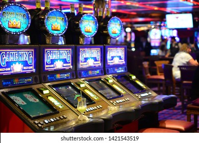 People are plaiyng gambling on a Game King casino slots on cruise ship, Carnival Cruise lines, Carnival Glory, Caribbean islands, May 23, 2019