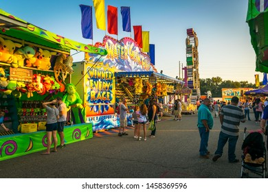 People play carnival games at the state fair