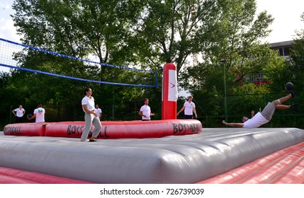 People play a new game Bossaball in Sofia, Bulgaria on 1 July 2017