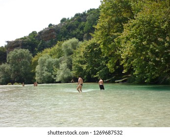 "People play and swim at ""Acheron"" river near Gliki village known from Greek mythology as the river of hades in Preveza Greece"