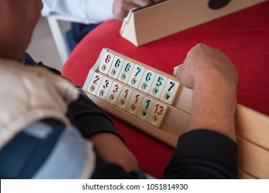 People play very popular logic table game rummikub