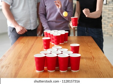 People playing beer pong in bar