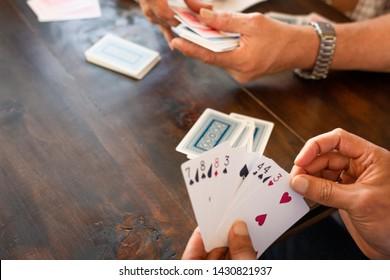 People playing card game card (Detail)