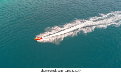 People are playing jet ski at sea during the holidays. Aerial view and top view.