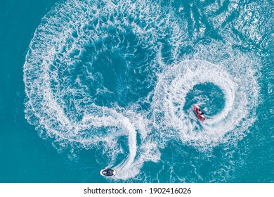 People are playing a jet ski in the sea. Aerial top view, amazing nature background. tropical beach. Outdoor sport and recreation activity, amazing aerial. Freedom adventure beach day