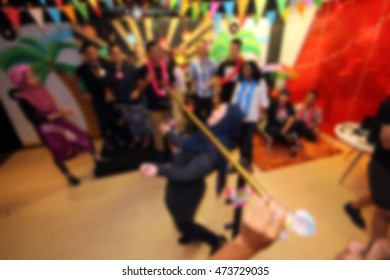 People playing limbo rock. Out of focus. blur image