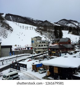 People playing ski in the morning of winter at Happo One Ski Resort, Hakuba, Hakone, Japan - December 27, 2017