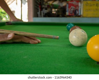 People playing snooker