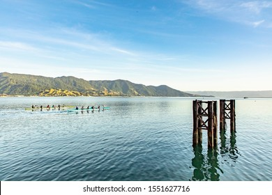 People playing sport paddling kayak in the bay between Ilhabela and Sao Sebastiao on the coast of Sao Paulo Brazil
