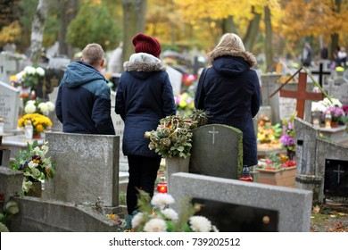 People at the Polish traditional cemetery on the feast of all saints day at 1st November and empty space for text