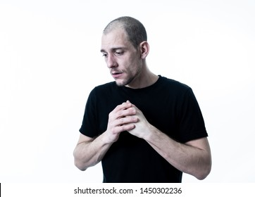 People portraits of human emotions and facial expressions. Young adult man in pain and depression with sad and exhausted face looking miserable and melancholy. Isolated on neutral white background.