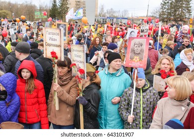 People with portraits of those who died in the war. Kirishi, Russia - 9 May, 2017. Holding a festive rally dedicated to the Victory Day.