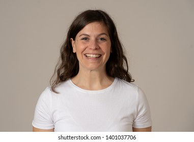 People, Positive human facial expressions and emotions concept. Close up portrait of attractive young caucasian woman with happy face and beautiful smile. Isolated on neutral background.