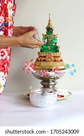 """People pouring and dropping water to Jade Buddha image on 13-14-15 April of every years that is """"Thai new year """" called """"Songkran Festival"""" or """"Water festival oF Thailand."""