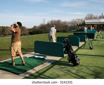 people practicing at driving range