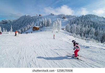 People practicing ski in Poiana Brasov, Romania