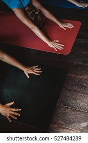 People practicing yoga and meditation in retreat studio class during Bali vacation recreation
