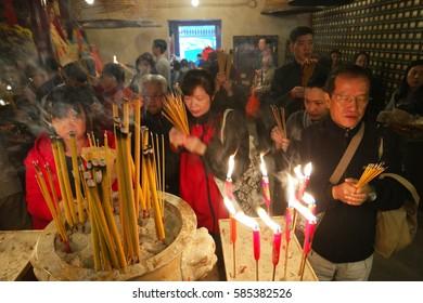 people pray at the Man MO Temple Hong Kong February 2017