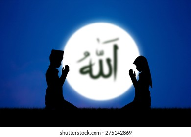 people praying to allah god of Islam on blue sky.The words spell is Allah means the God of Islam.
