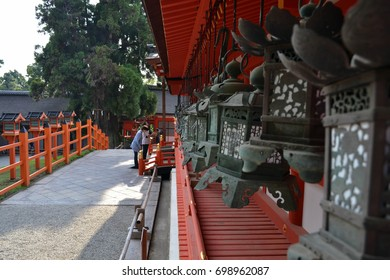 People praying at Kasuga Taisha, the famous shrine in Nara (Japan) - focus on the people. Pic was taken in August 2017.